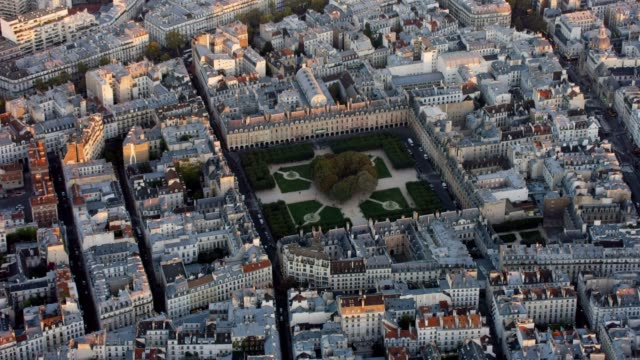 aerial flying over paris france looking at place des vosges, sunset - バスティーユ点の映像素材/bロール