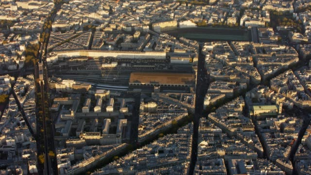 aerial flying over paris france looking at railroad stations, sunset - railway station stock videos & royalty-free footage