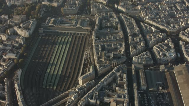 aerial flying over paris france looking down at railroad station gare de l'est, morning - schienenverkehr stock-videos und b-roll-filmmaterial