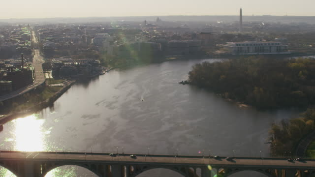 aerial flying over potomac river, and francis scott bridge towards the john f. kennedy center for the performing arts, dc - john f. kennedy center for the performing arts stock videos & royalty-free footage
