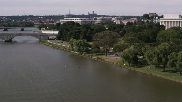 aerial flying over potomac river in front west potomac park dc - john f. kennedy center for the performing arts stock videos and b-roll footage