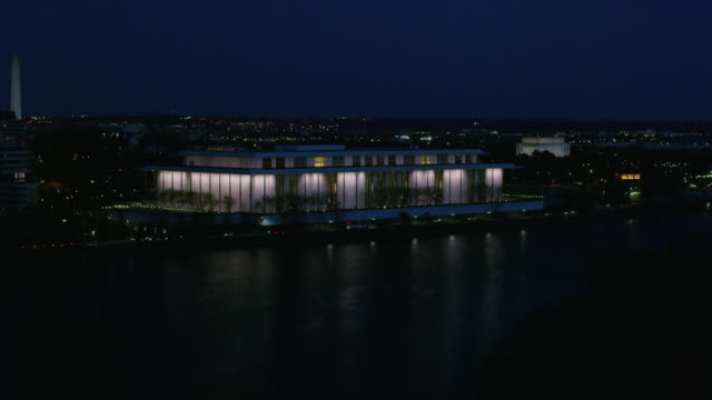 aerial flying over potomac river looking at the john f. kennedy center for the performing arts at night - performing arts center stock videos & royalty-free footage