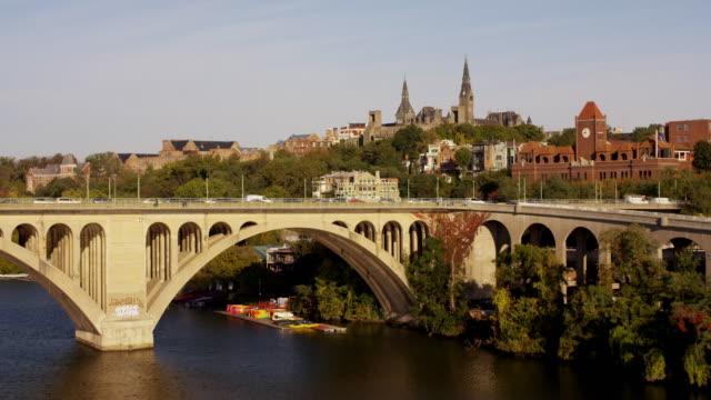 vidéos et rushes de aerial flying over potomac river towards georgetown university dc - georgetown washington dc