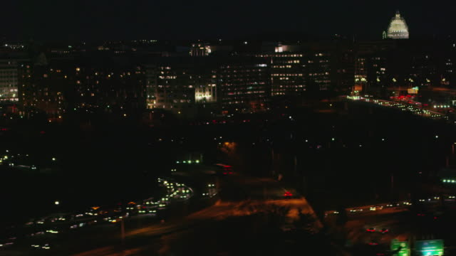 Aerial flying over Potomac River view of Washington DC at night