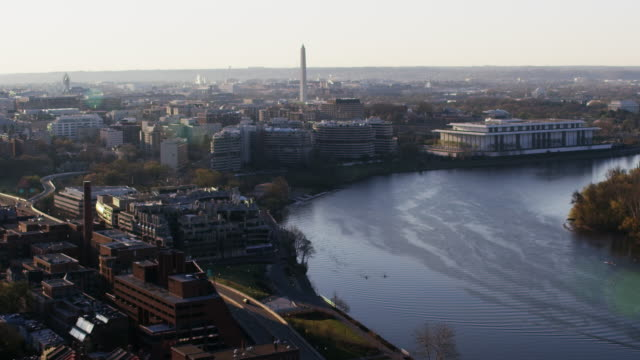 aerial flying over potomac river view of washington dc morning sun - potomac river stock-videos und b-roll-filmmaterial