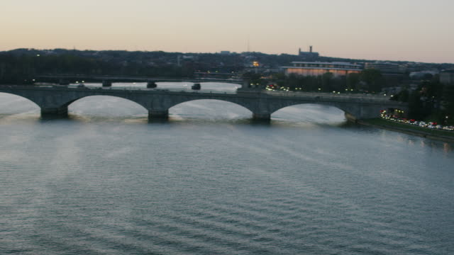 aerial flying over potomac river with view of washington dc at sunset - john f. kennedy center for the performing arts stock videos and b-roll footage