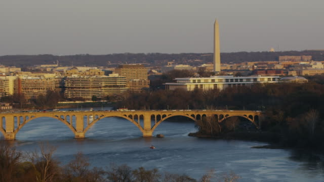 stockvideo's en b-roll-footage met aerial flying over potomac river, with view of washington monument - d day
