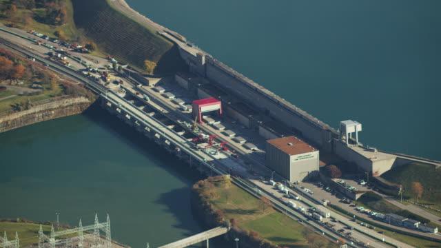 aerial flying over power station, niagara falls, ontario, canada, daytime - river niagara stock videos & royalty-free footage