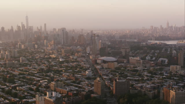 Aerial flying over Prospect Park with view over Brooklyn and Manhattan in NYC