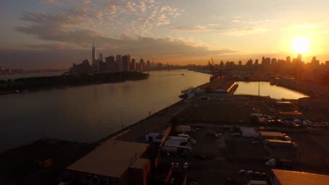 aerial flying over red hook brooklyn at sunrise towards manhattan - dawn stock videos & royalty-free footage