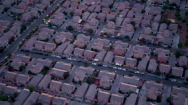 aerial flying over residential suburb of north las vegas, sunrise - nevada stock videos & royalty-free footage