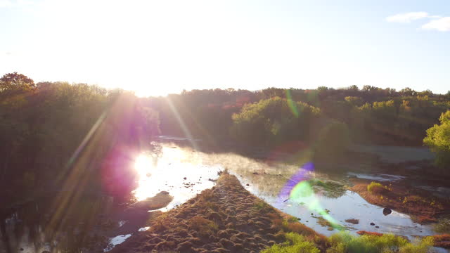 aerial flying over river at sunrise in the fall - new paltz stock videos and b-roll footage