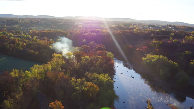aerial flying over river in the fall towards the sun, morning - ulster county stock videos & royalty-free footage