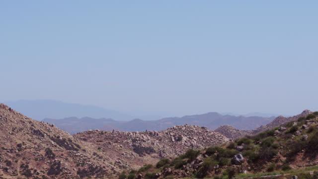 Aerial flying over rocky ridge, California Daytime