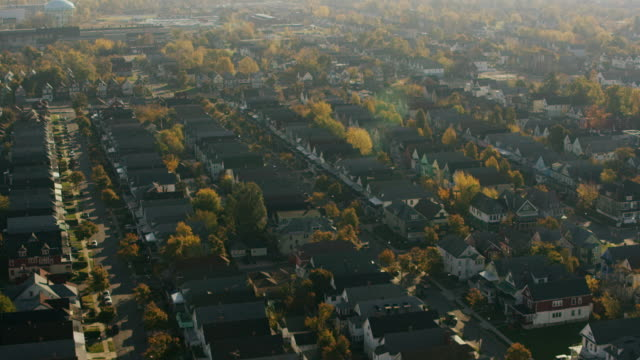 aerial flying over rows of houses in suburbs of buffalo ny - buffalo new york state stock videos & royalty-free footage