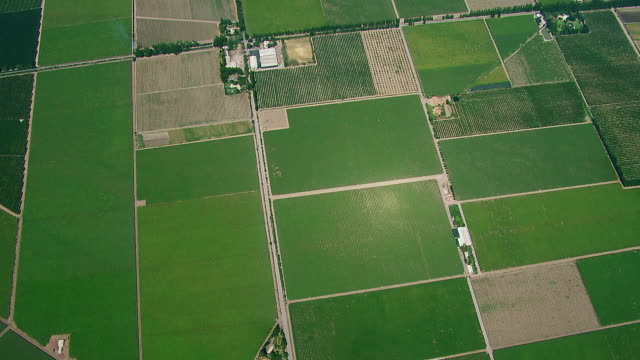 vidéos et rushes de aerial flying over rural farm patchwork - patchwork landscape