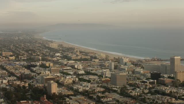 Aerial flying over Santa Monica in Los Angeles, CA sunset