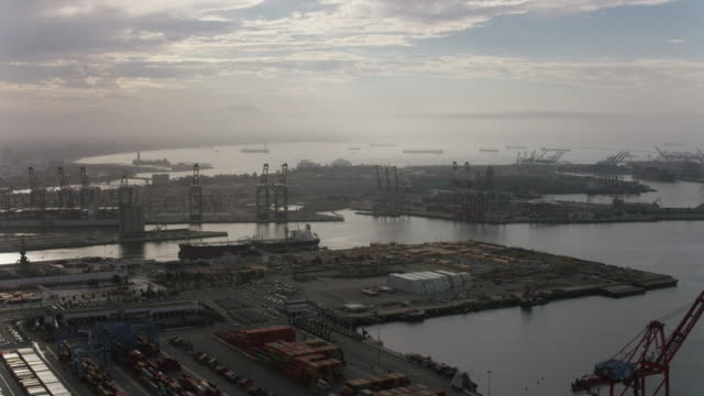 aerial flying over shipping area port of long beach, ca - long beach california video stock e b–roll