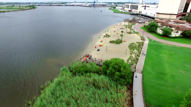 Aerial Flying Over small Beach next to Lake Charles waters edge in Louisiana