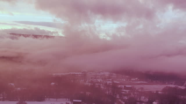 aerial flying over snow covered landscape, sunset - contea di ulster stato di new york video stock e b–roll