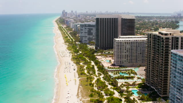 aerial flying over south beach miami in miami fl - マイアミ点の映像素材/bロール
