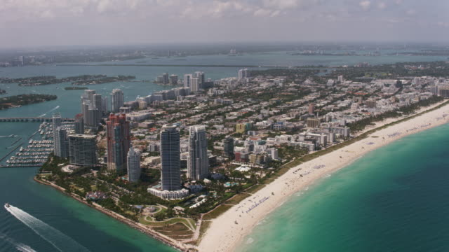 aerial flying over south beach miami in miami fl - south beach stock videos & royalty-free footage