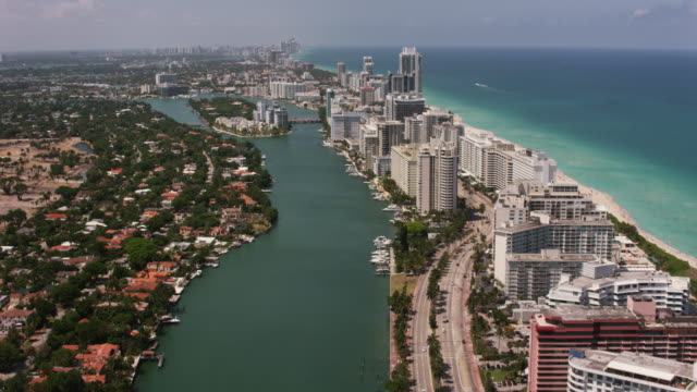 aerial flying over south beach miami in miami fl - フロリダ州点の映像素材/bロール