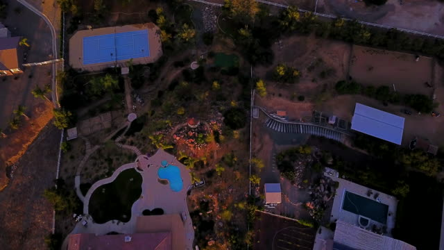 aerial flying over southern california hilly residential area at sunrise - riverside california stock videos and b-roll footage