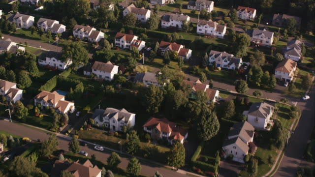 Aerial flying over suburban town with rows of houses