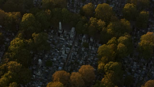 aerial flying over the cimetière de montmartre in paris france, sunset - cemetery stock videos & royalty-free footage