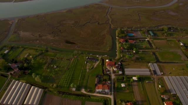 aerial flying over the country, farmland outside of venice italy, sunset - wet wet wet stock videos & royalty-free footage