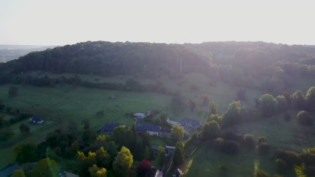 vidéos et rushes de aerial flying over the countryside of france, morning - normandie