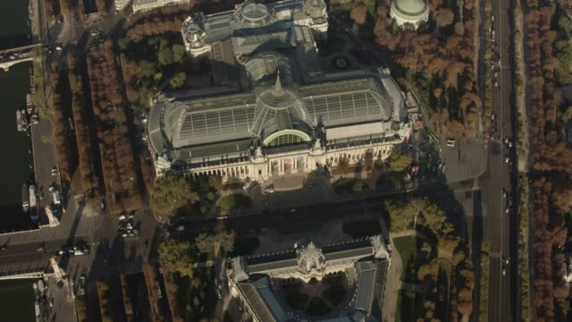 aerial flying over the grand palais in paris france, daytime - grand palais stock-videos und b-roll-filmmaterial