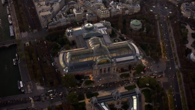 aerial flying over the grand palais in paris france, sunset - grand palais stock-videos und b-roll-filmmaterial