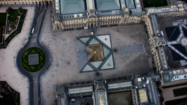 aerial flying over the musée du louvre in paris france - louvre stock videos and b-roll footage