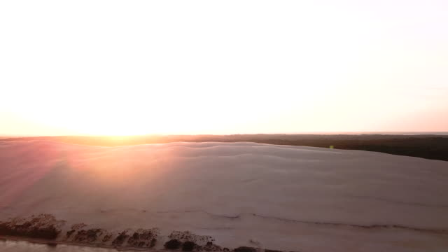 aerial flying over the ocean in front of dune of pilat in france at sunrise - arcachon stock videos & royalty-free footage