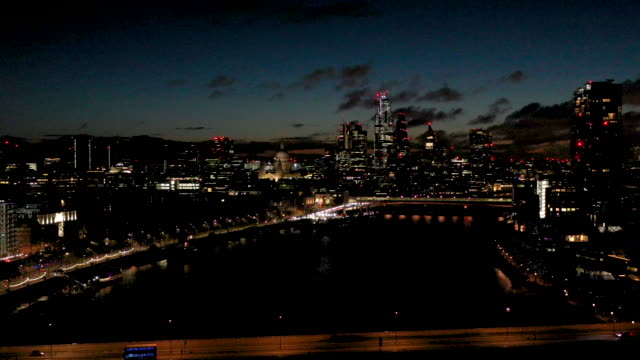 aerial flying over the river thames and over waterloo bridge london uk, at night - drone point of view stock videos & royalty-free footage
