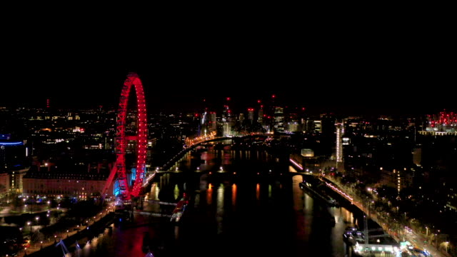 aerial flying over the river thames in london uk at night, city full of lights - hungerford bridge stock videos & royalty-free footage