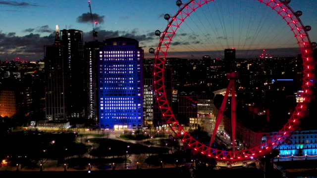 aerial flying over the river thames past the london eye in london uk at night, city full of lights - aerial view stock videos & royalty-free footage