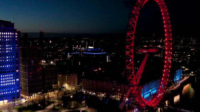 aerial flying over the river thames past the london eye in london uk at night, city full of lights - famous place stock videos & royalty-free footage