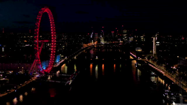 aerial flying over the river thames towards westminster bridge, london uk at night - aerial view stock videos & royalty-free footage