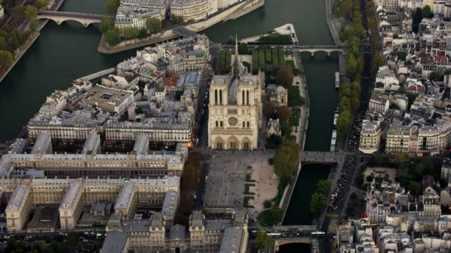 aerial flying over the seine river towards cathédrale notre-dame de paris, in paris france at sunset - river seine stock videos & royalty-free footage