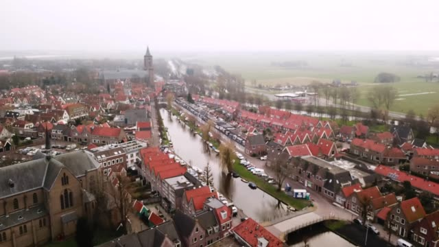 aerial flying over town outside city of amsterdam, netherlands - amsterdam stock videos & royalty-free footage