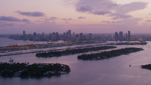 Aerial flying over Venetian Islands at sunset Miami FL