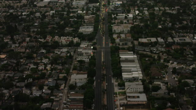 Aerial flying over Venice Blvd in Los Angeles CA, rush hour