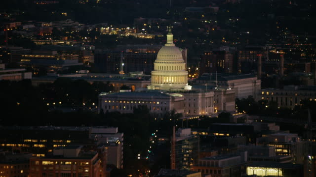 Aerial flying over Washington DC, United States Capitol, night