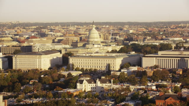 Aerial flying over Washington DC, view of United States Capitol Daytime
