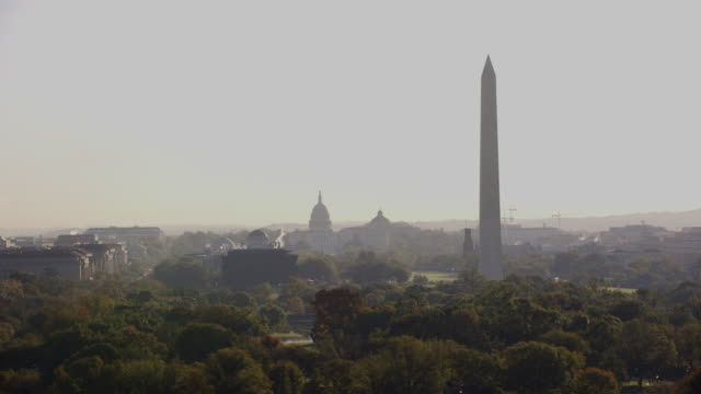 aerial flying over washington dc view of washington monument, morning - washington dc stock videos & royalty-free footage
