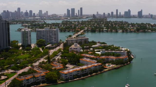 Aerial flying over water past Venetian Islands, Miami FL