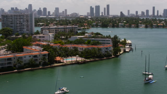 Aerial flying over water, Venetian Islands, Downtown Miami FL